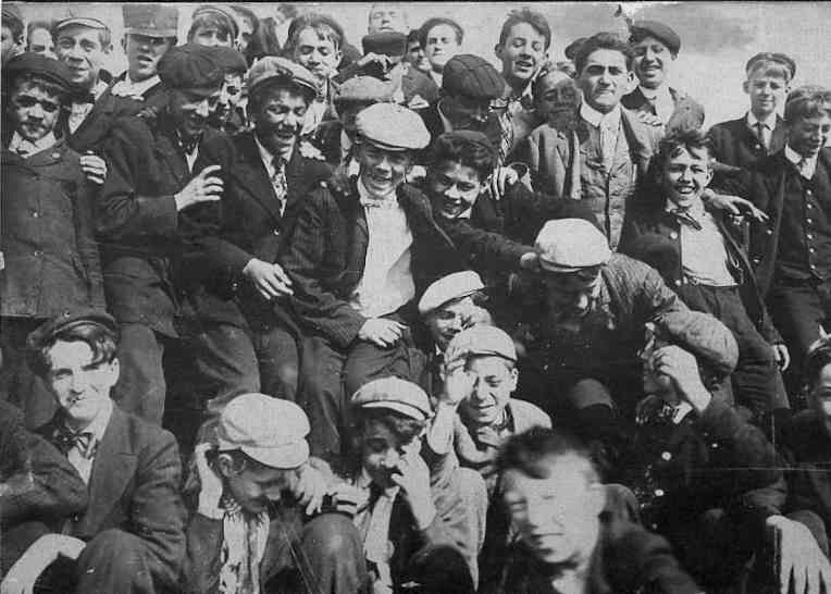 Figure 1.--This undated photograph was probably taken in the late 1900s. It  shows how common flat caps were for teenagers. Note the different styles. de59b436a14